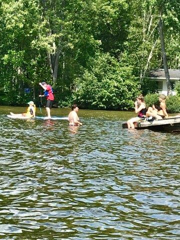 family in water on raft